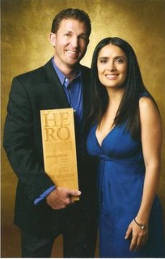 David receiving his CNN Hero Award from Salma Hayek