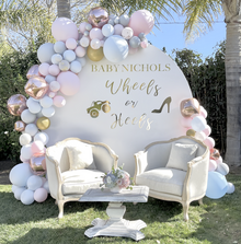 Gender reveal balloon backdrop wheels or heels party