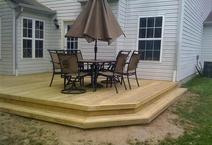 Custom built deck with covered areas.
