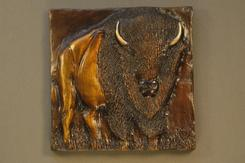 Bronze relief of a bison