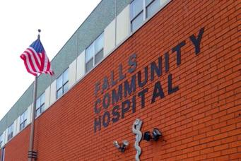 Front of FCHC hospital with flag