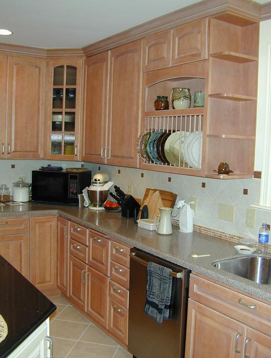 Beautiful solid surface countertops in perimeter of kitchen