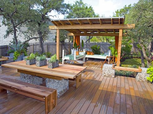 Beautiful custom deck with arbor and picnic table seating area.