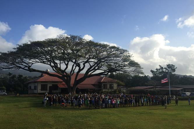 photo of Kalaheo School students gathering at the center of school campus for morning oli