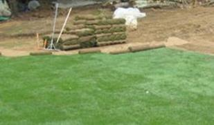 image of new sod being put down by Presentato Landscape