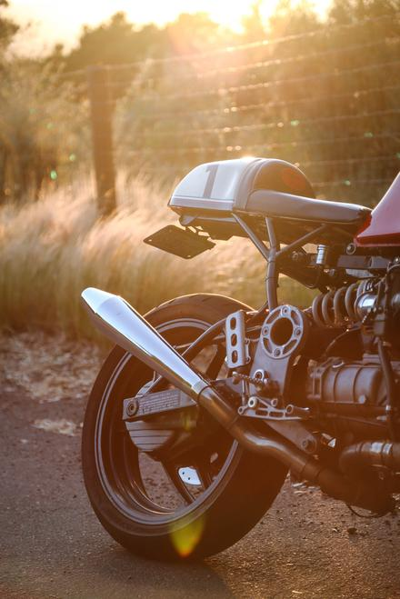 cafe racer motorcycle with napa valley forest lifestyle sunset