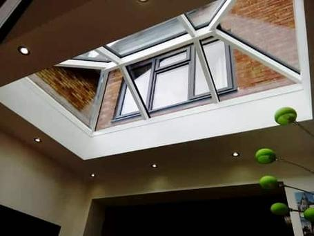 Skylight window fitted in roof of house extension