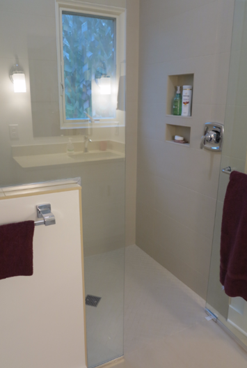 Curbless shower stall and new shower glass enclosure are some of the elements in this barrier free bathroom.