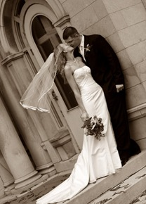 Newlyweds kiss on their wedding day at Gale Mansion in Minneapolis
