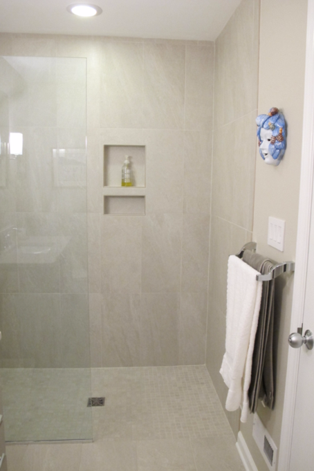 Curbless shower stall in guest bathroom before renovation