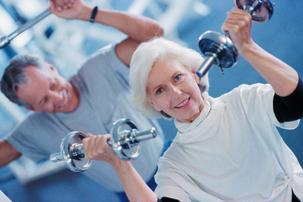 Mature couple weight lifting at a Private retreat center for muscle conditioning and strength.