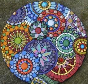 A round Mosaic depicting flowers.