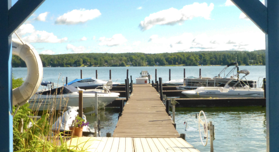 Photo of the dock and lake at Swan Valley Marina on beautiful Lake Charlevoix in northern Michigan