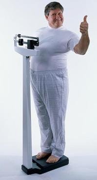Overweight mature man on top of a weight scale