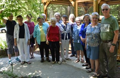Photo of a group of FriendShip members and volunteers at an outdoor event.