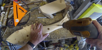 How to make a beach decor fish shaped towel rack. Drilling holes for the wood dowels. www.DIYeasycrafts.com