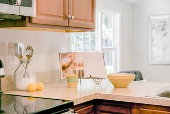 Vacant home staging always includes delicate accessories in the kitchen. Open recipe books, cooking utensils and bowls can make a potential buyer see themselves cooking in this kitchen.