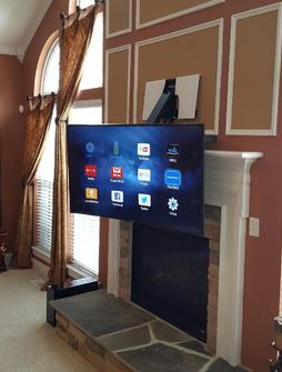 4K Ultra HD Curved TV Mounted over Fireplace using Dynamic Mounting's down and out mount. TV easliy pulls down in front of fireplace for a lower viewing height. Carolina Custom Mounts, Charlotte NC
