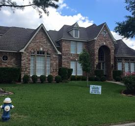 House that had roofing services done in Spring, TX.
