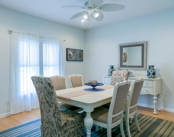 The interior design of this Southern Maryland home included a new coastal dining room.