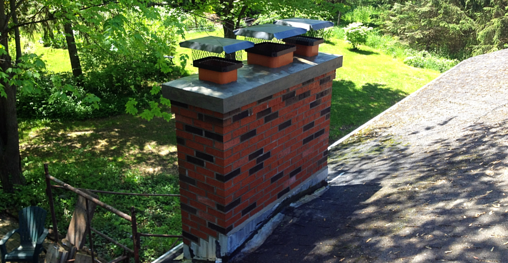 Home chimney that has been repaired. Tuckpointing, replacement bricks, and a new cap.