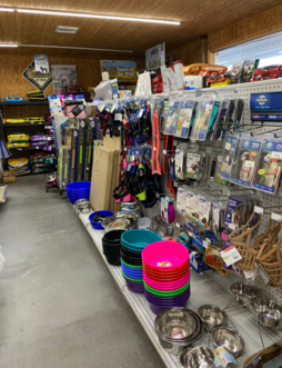 Dog cages, feeder pans, muzzles and more, Remington Feed Dog Supply aisle.