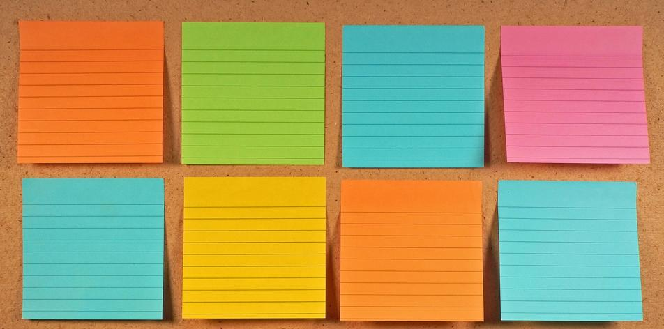 Background image of empty post it notes on a pin board