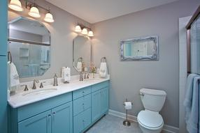 Guest bathroom gets remodeled with sea blue cabinety