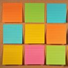 Post-it notes on a corkboard