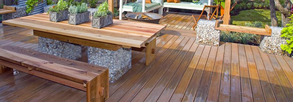 Custom built deck with a built-in picnic table.