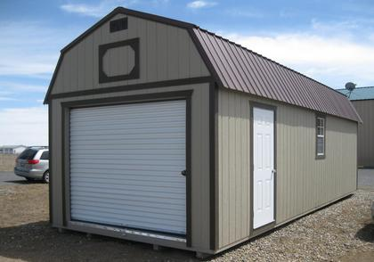 Weather King's Garage with roll up door and reinforced floors to accommodate the weight of a car.