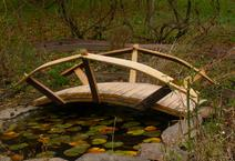 fully functional garden bridges made from the reclaimed oak staves of a wine barrel. Sizes range from three feet up to twenty feet overall length.
