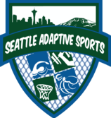 A shield-shaped logo that says Seattle Adaptive Sports in white text over a green banner. The logo is outlines in blue and has four smaller graphic images below the text: a swimmer, barbell, basketball hoop, and a racing wheelchair.