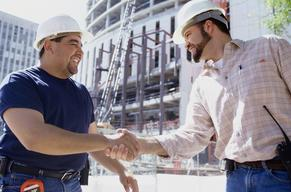 Two Electricians sharing a firm handshake with each other in the San Francisco Bay Area, CA.
