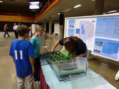 Students at a conference exploring the Ward's Flood Model as part of the Flood Risk in Schools Program.