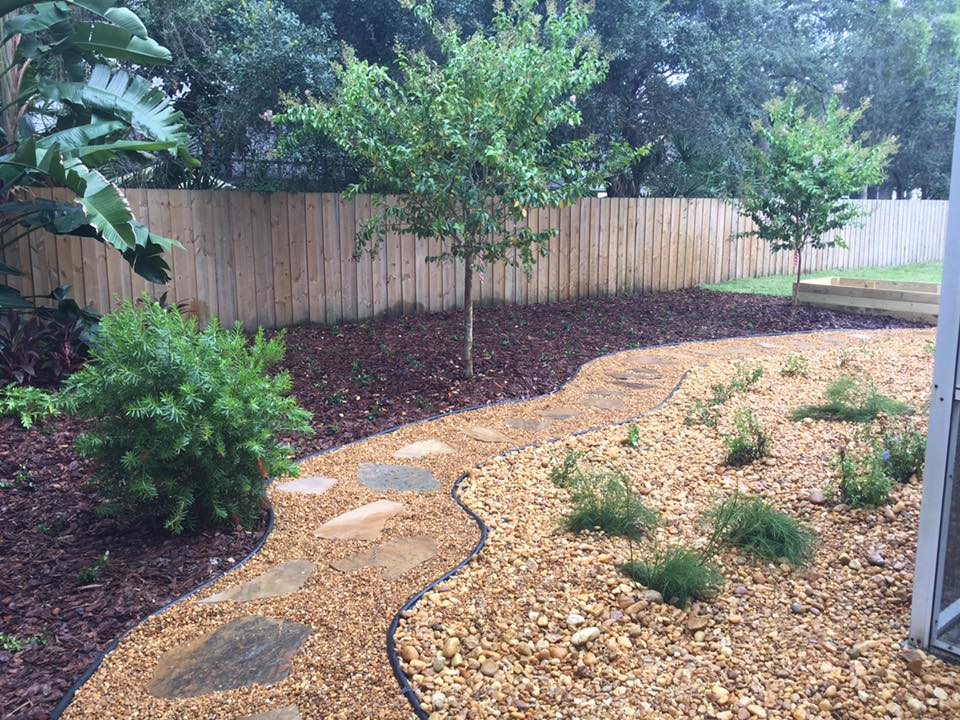 Pinebark Mulch and Brown River Rock - Central Florida Landscaping And Maintenance, Inc In Oviedo, Fl