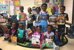 Pre-k Students posing with their favorite book