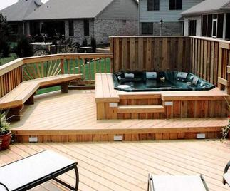 Split level deck with built-in planters and railing.
