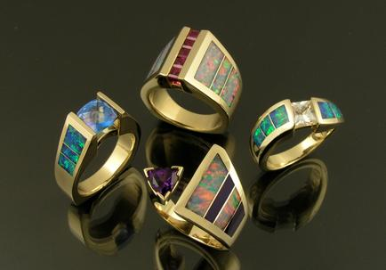 Australian opal rings with a variety of colored gemstone accents set in 14k gold.