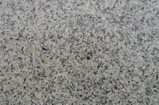 Crema Caramel Granite creamy brown, black, white. A durable color for heavy use kitchens. A great color for house flipping.