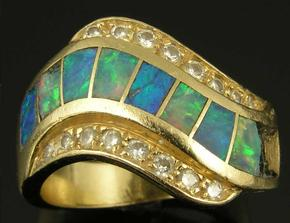 Australian opal inlay ring in need of repair.