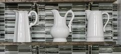 Chesapeake Staging & Design feels when staging a vacant home it's the details that count, including these white pitchers in this newly redesigned kitchen.