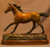 Bronze Thoroughbred horse running statue