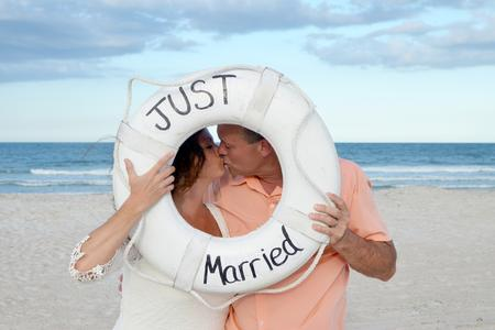 A bride and groom sharing a kiss for their St. Augustine Beach Wedding Photos.