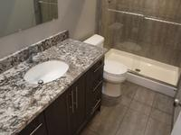 This basement bathroom development was completed as part of a full basement development in Willowgrove. Features include a custom vanity with granite counter top, and recessed pot light in shower.