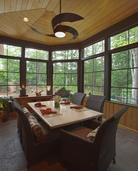 EZE Breeze screened porch, custom tile flooring, bead board ceiling are all features in this screened porch addition