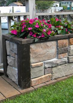 How to build an easy DIY stone veneer raised planter. FREE step by step instructions. www.DIYeasycrafts.com