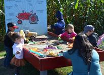Picture of Children digging in Hank's Tractor Dig Table