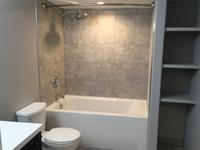 This basement bathroom renovation was a complete gut and ultimately a brand new bathroom development. Layout was kept the same, but otherwise every element was replaced and upgraded. Features a deep soaker tub.