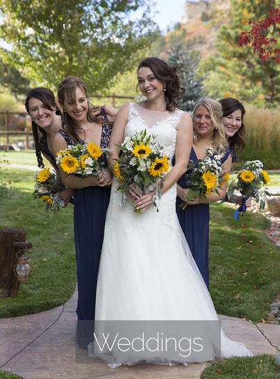 bride with fun bridesmaids holding sunflower bouquet
